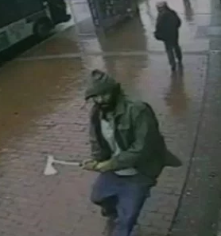 Ax wielding man attacks NYPD officers.
