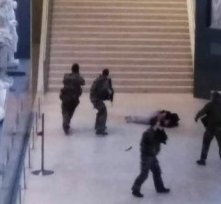 Louvre attacker shot by French soldiers.